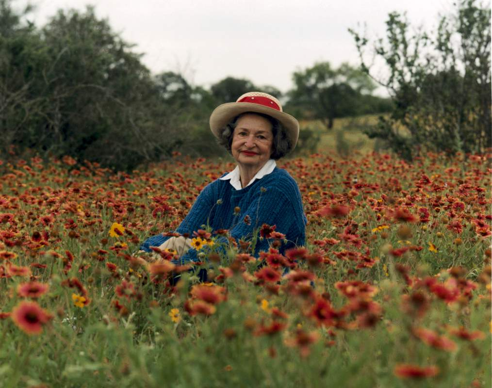 Lady Bird Johnson, the First Lady, among wildflowers near Fredericksburg TX.
