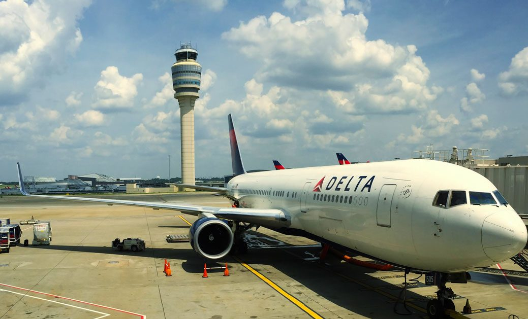An ATC Tower an airliner at a large airport - FAA ATC Hiring Process To Be Reviewed In Congressional Hearing