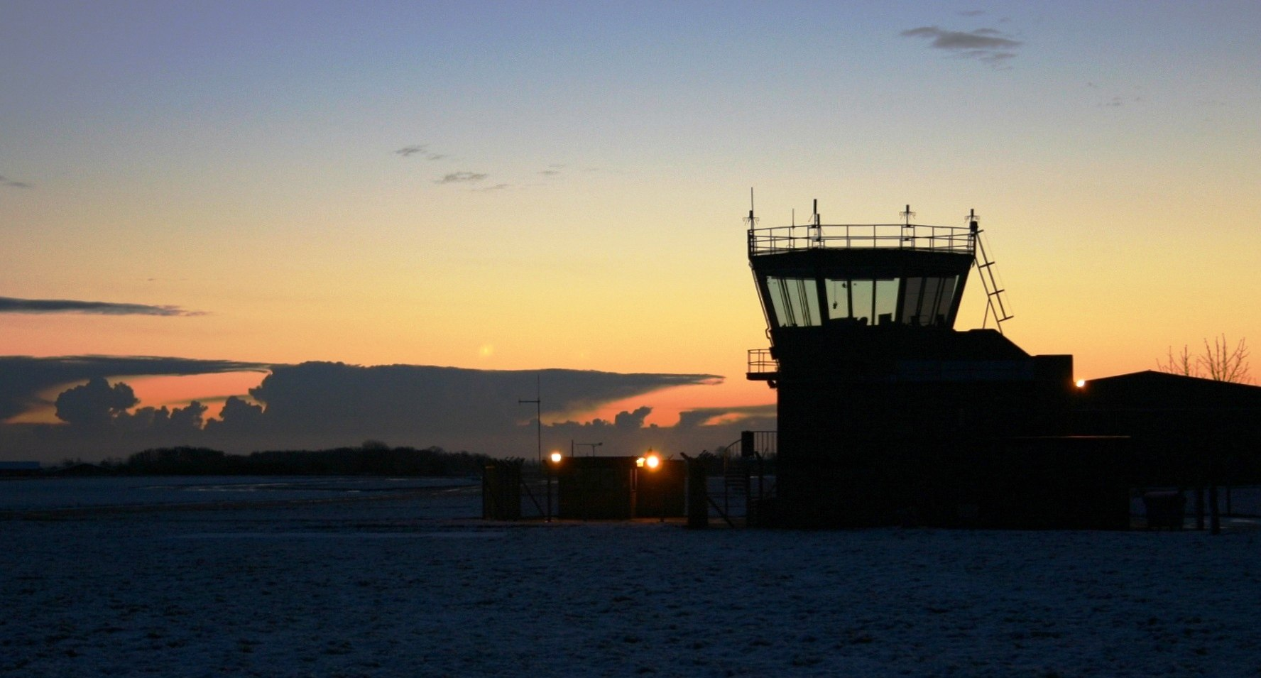 An ATC tower at dusk.