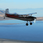 A n aircraft flying over the Great Salt Lake - Aerodynamics and the Four Forces