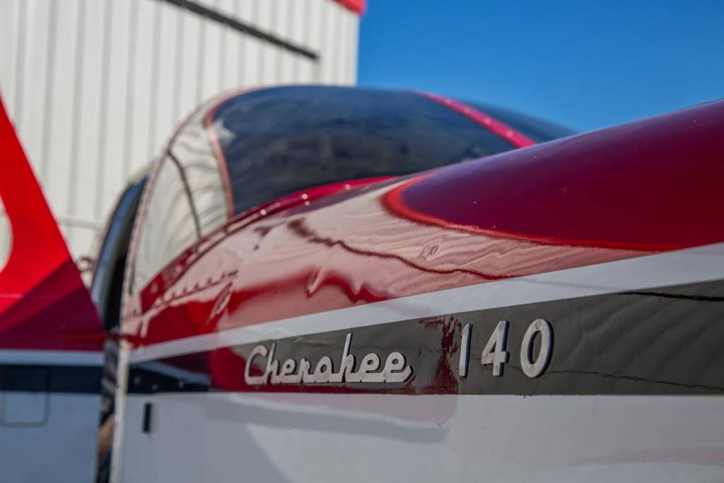 Cherokee 140 outside a hangar