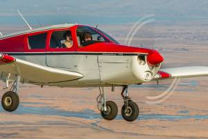 A Piper Cherokee 140 flying over the Great Salt Lake