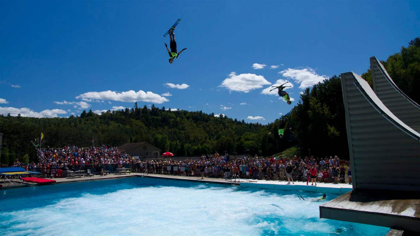 Ski Jumpers landing in the pool at Whitehead Mountain ski resort - Accessible from the Lake Placid Airport