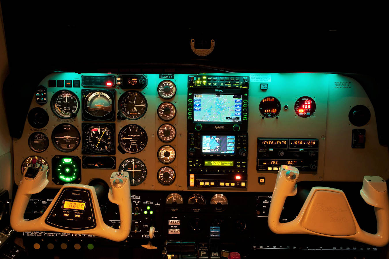 The instrument panel of a Beechcraft A36 Bonanza at night, ready for instrument flying.