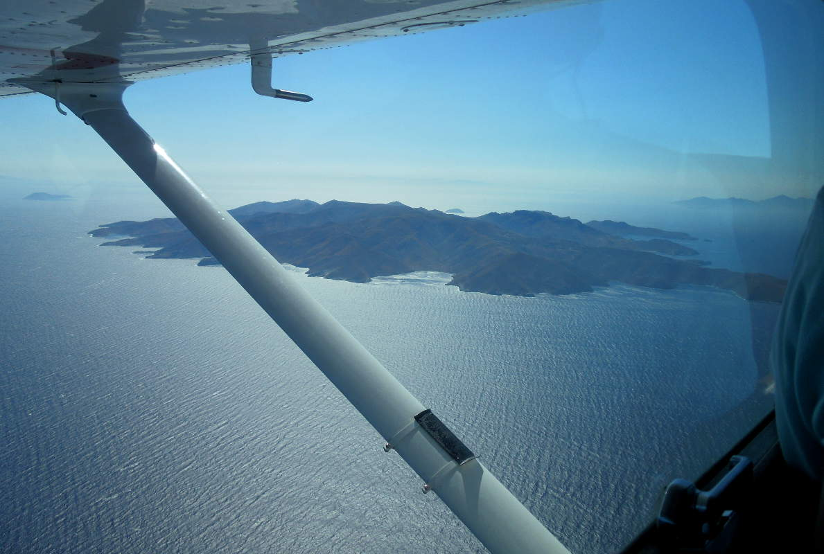 The western coast of Serifos and Antiparos in the far distance on the right, on the way to Paros.