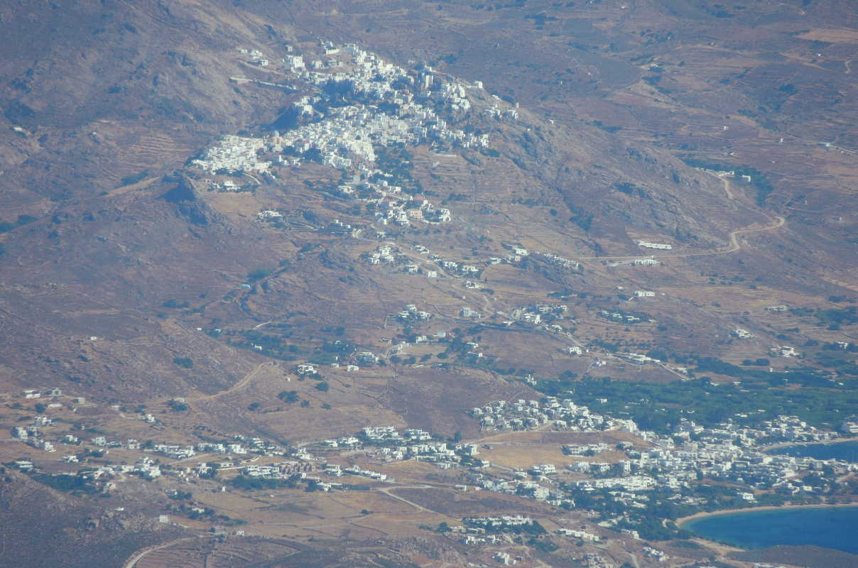 The town of Serifos is carefully located above the coast, seen flying from Paros.