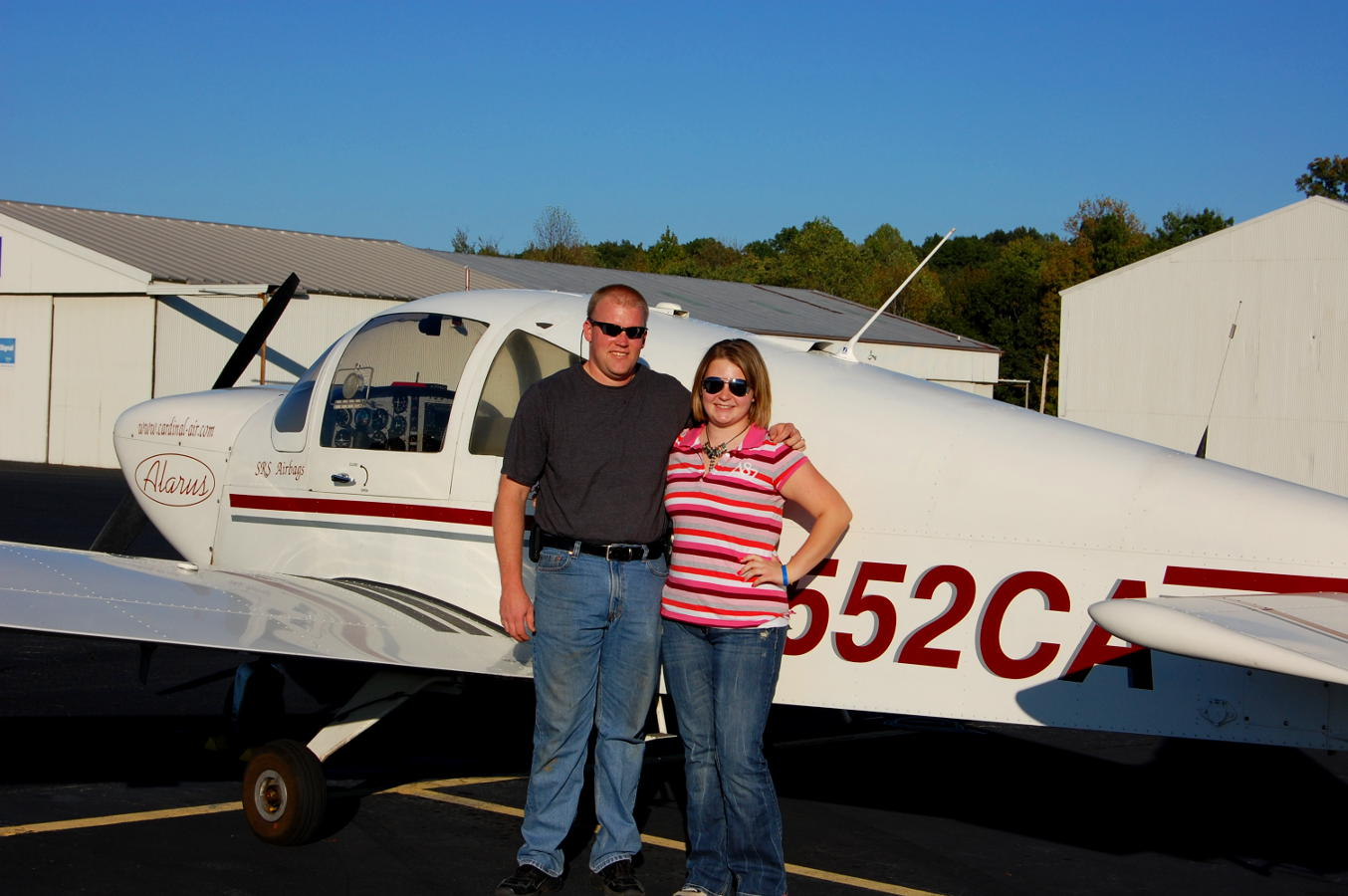 Student pilot and her father in front of a small aircraft - My Discovery Flight