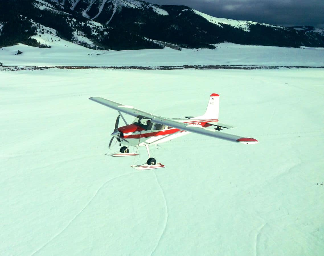 Without using an intrumnet rating to fly IFR, a pilot could become disoriented with a white, snowy landscape.