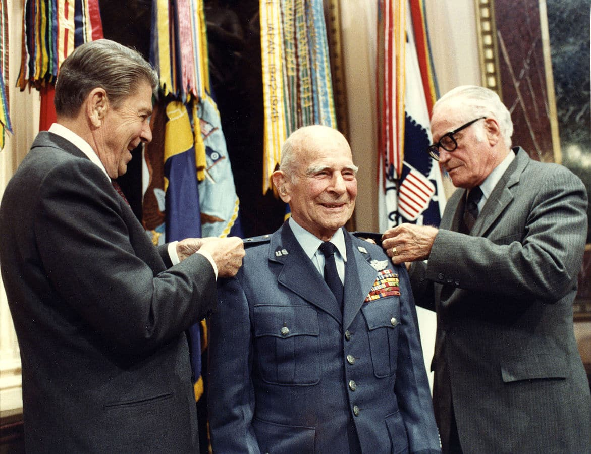 President Ronald Reagan and Senator Goldwater pinning a medal on General Jimmy Doolittle.