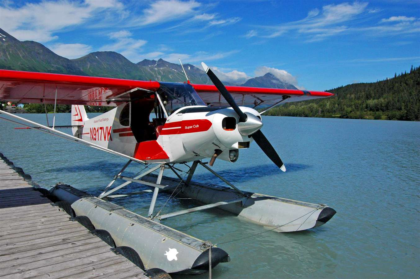 Seaplane tied up to a dock on an Alaskan lake.