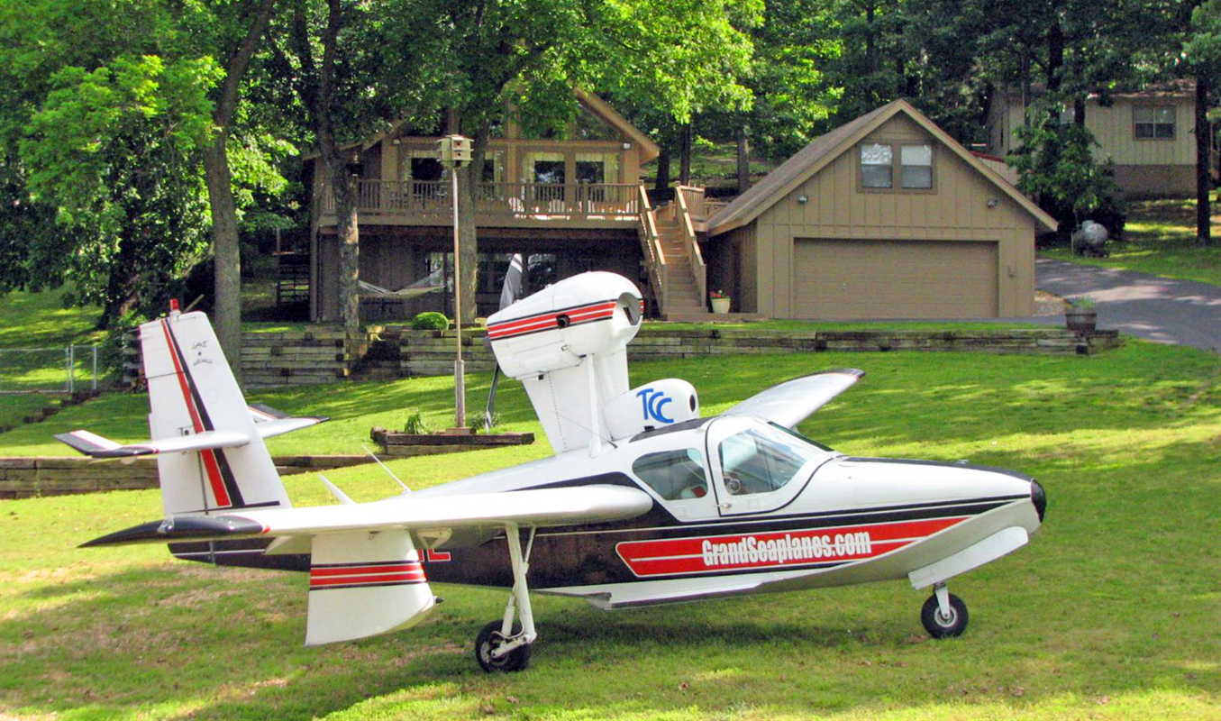 A seaplane parked on a grass airstrip, used by Grand Seaplanes to train pilots.