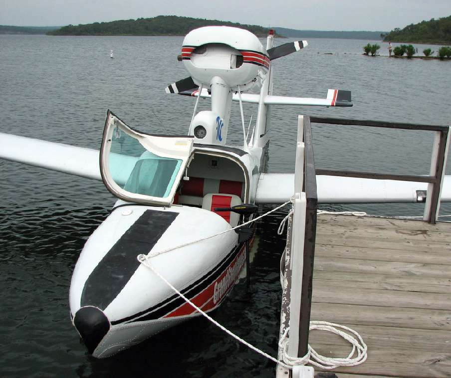 A seaplane tied up to a dock.
