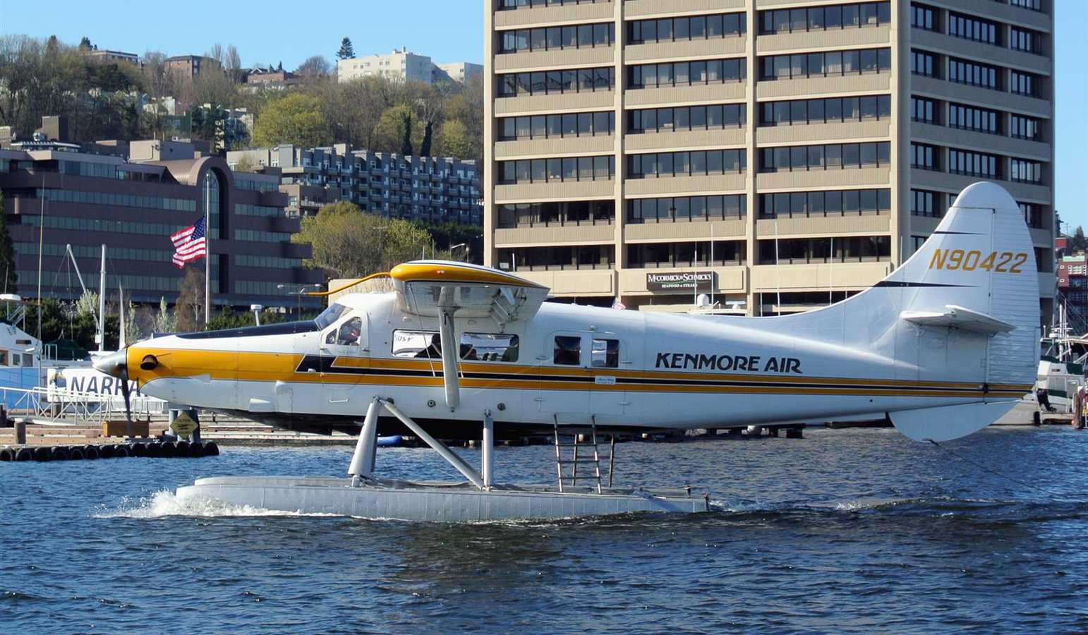 Kenmore Air seaplane taxiing in the harbor.