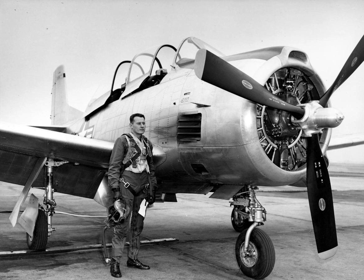 Bob Hoover standing next to a T28B aircraft.