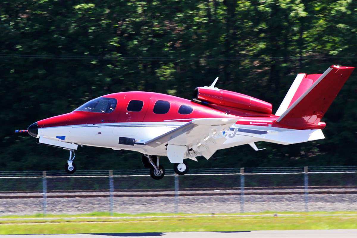A Cirrus Vision SF50 Jet landing on a runway.