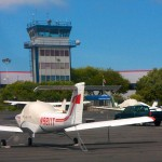 Small aircraft parked near an ATC tower - Follow Up on the FAA Hiring Scandal