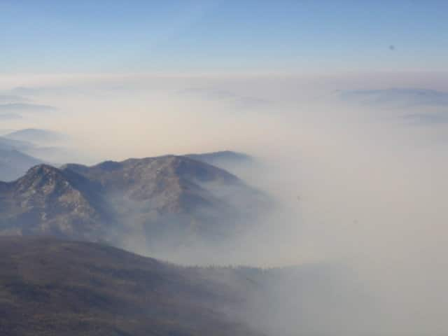 Aerial view of the thick smoke from forest fires that cause TFRs.