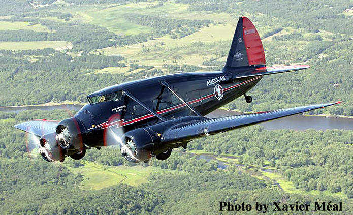 A restored Stinson Model A in flight.