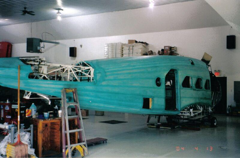 The airframe of a Stinson Model A aircraft undergoing fabric restoration work.
