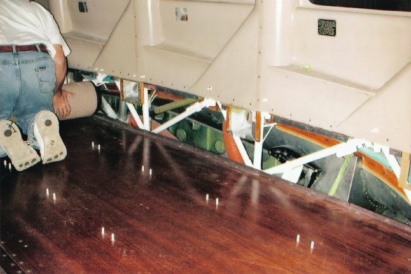 The interior floor being restored on a Stinson Model A aircraft.