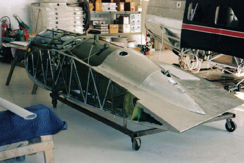 The metal frame of a Stinson Model A aircraft being restored.