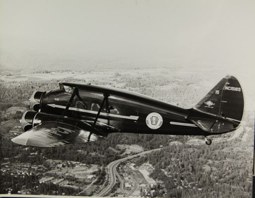 A Stinson Model A aircraft flying in the 1930s.
