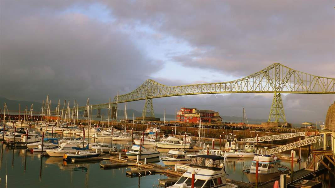 The Astoria-Megler bridge with clouds behind, visible when you visit Astoria Oregon.