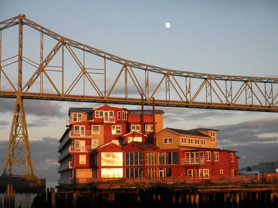 The Cannery Pier Hotel and Spa, in the dusk light, which you can see when you visit Astoria Oregon.