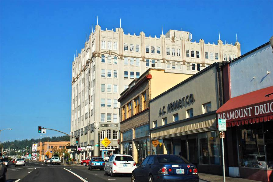 A view of downtown Astoria and the Hotel Astoria, which you can see when you visit Astoria Oregon.
