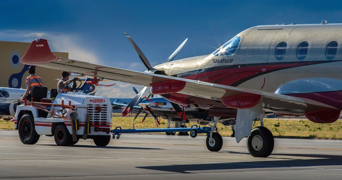 A Pilatus PC-12 being pulled by a tug - 5 Rules for Taking Great Aviation Photos