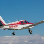 A Piper Cherokee in flight, with a flight instructor and student pilot - Why Are Fewer People Pursuing a Pilot License?