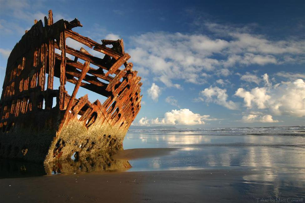 The Peter Iredale wreck with a cloudy sky, which you can see when you visit Astoria Orgeon.