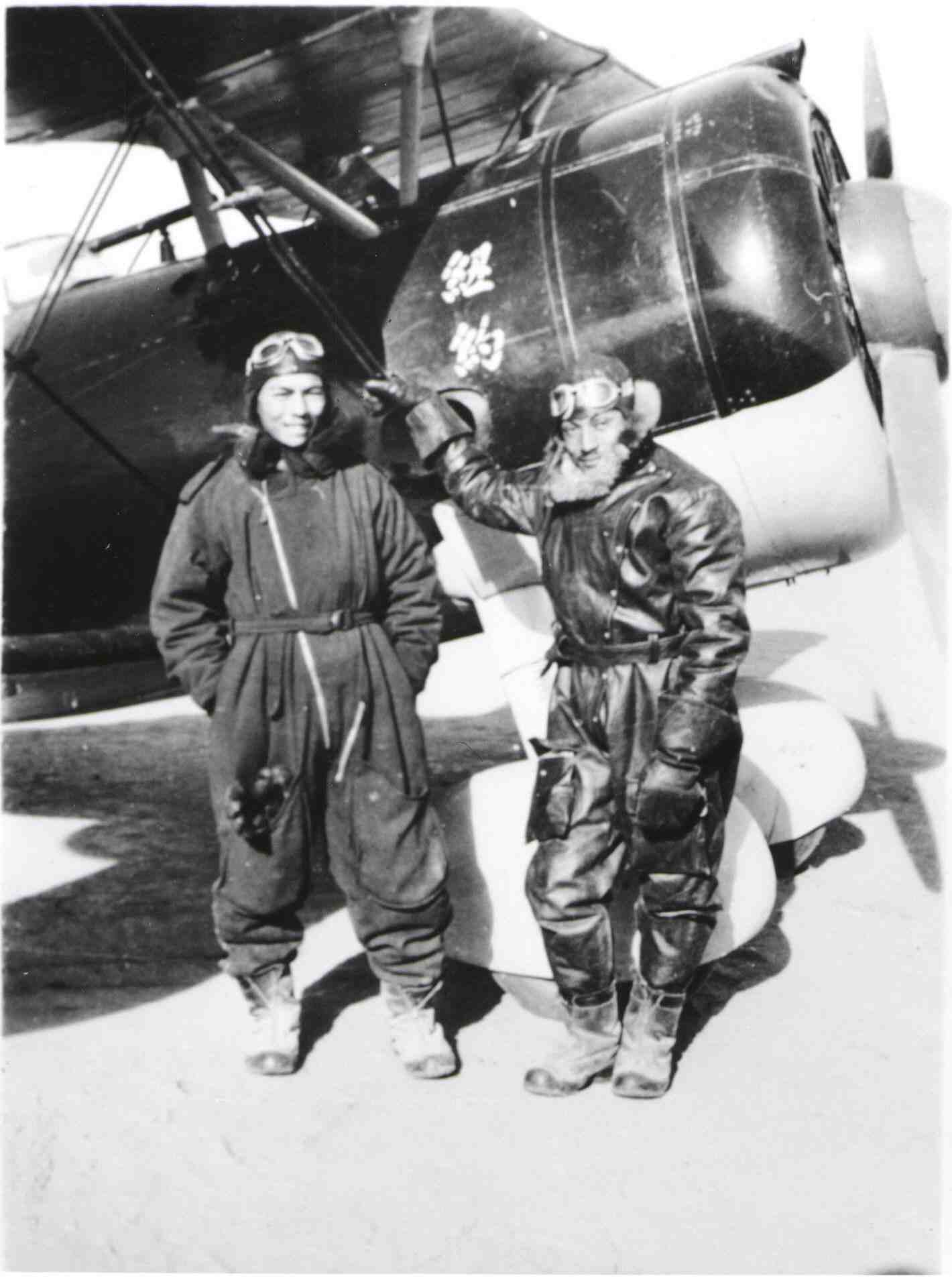 World War 2 fighter pilot Arthur Chin standing next to a Russian-built Polikarpov I-152 biplane fighter.