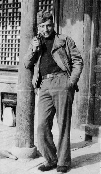 World War 2 flying ace Arthur Chin posing with a pipe, in China.