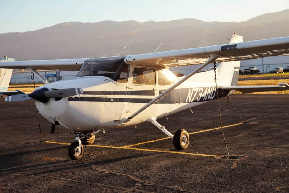 Cessna 172 Skyhawk parked at an airport, a great private plane for a general aviation pilot.