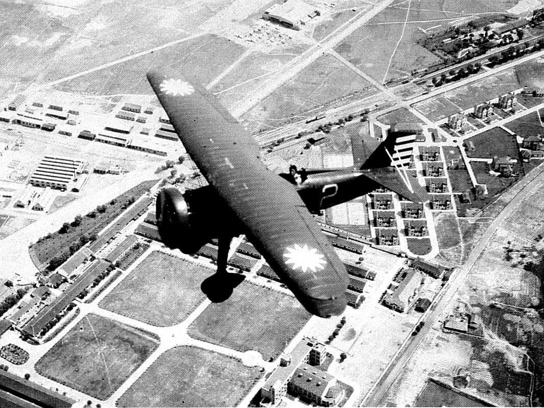 Chinese Curtiss Hawk II in flight, used in World War 2 combat.