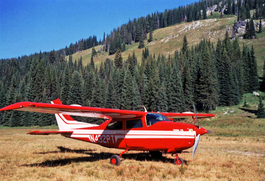 A Cessna 210 Centurion, flown by a private pilot with a pilot's license, parked at Wilson Bar airstrip in the Idaho Backcountry.