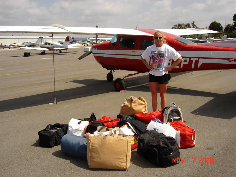 A private pilot standing next to her Cessna 210 Centurion, which is tied down at airport parking - And All This Happened before I Got My Pilot's License.
