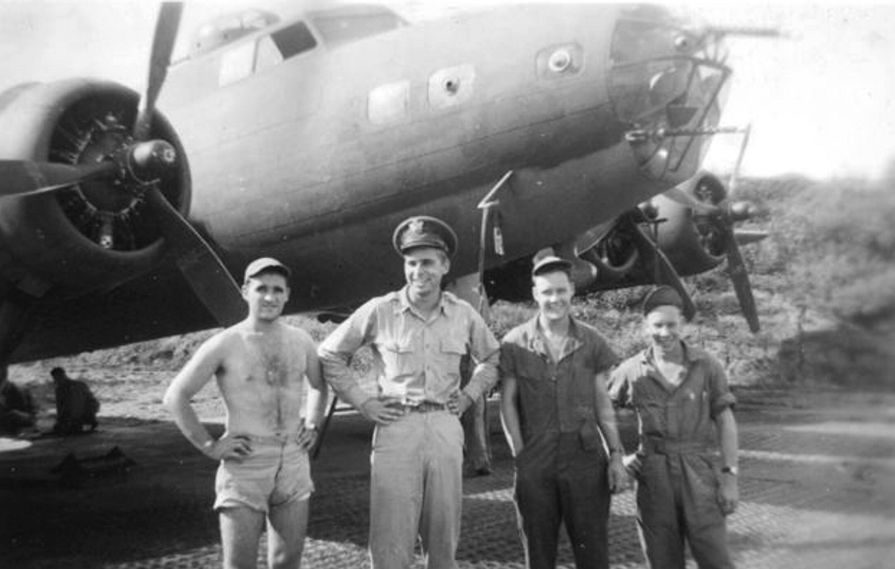 Gene Roddenberry and his flight crew stand in front of a B-17 Flying Fortress, during World War 2.