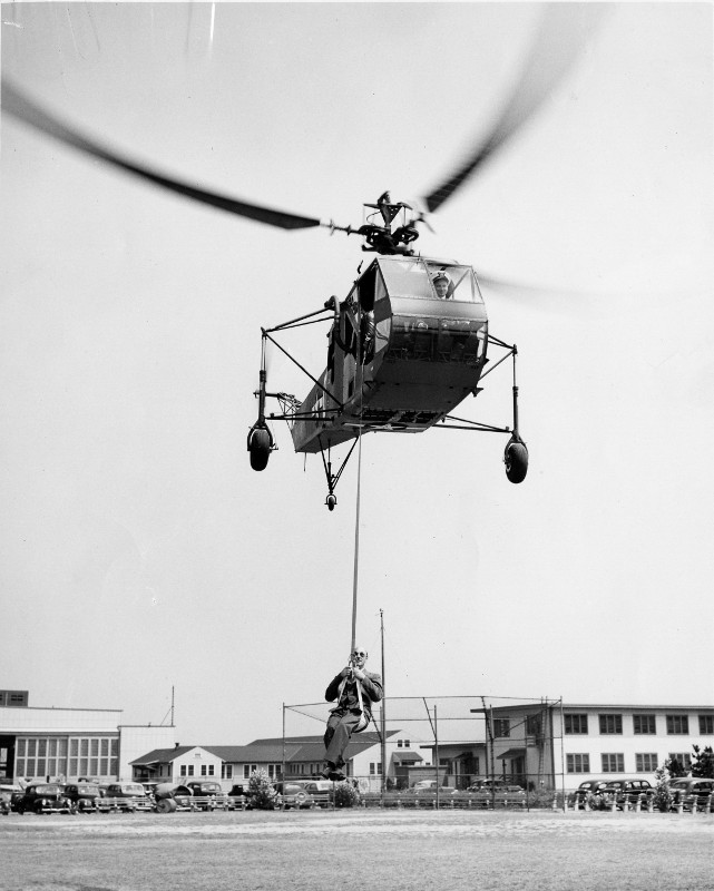Igor Sikorsky being hoisted in an R4 Helicopter, his first helicopter design to be mass produced.