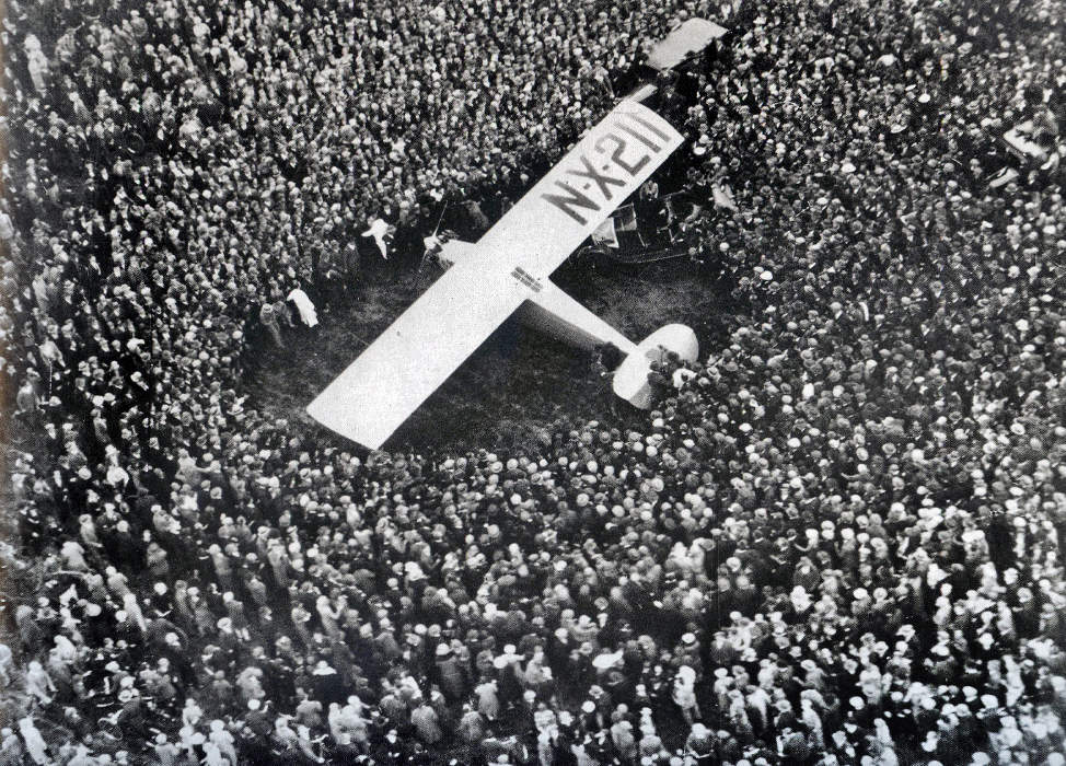 Charles Lindbergh lands the Spirit of St. Louis in France.