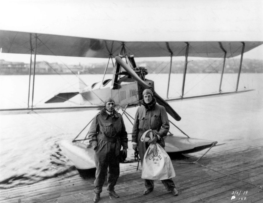 William Boeing and Eddie Hubbard in front of an aircraft, in 1919.