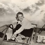 Jacqueline Cochran, or Jackie Cochran, emerging from the cockpit of an airplane.