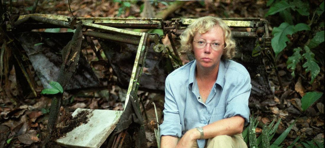 Juliane Koepcke next to aircraft wreckage in the jungle