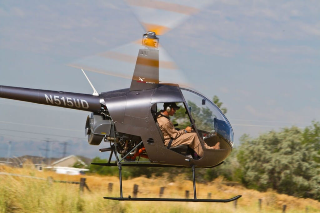 A Robinson R22 Helicopter flying.
