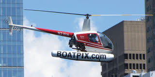 A Robinson R22 Helicopter, Mariner variant, in flight.