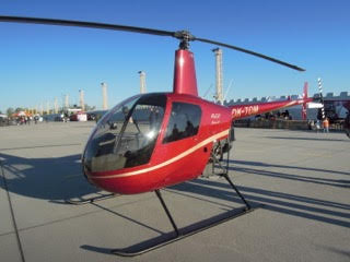 A Robinson R-22 Helicopter on the runway.