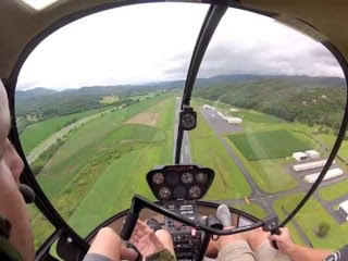 The view from inside the cockpit of a Robinson R22 Helicopter.