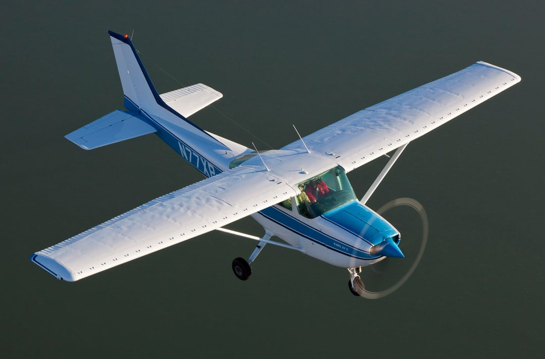 Cessna 172 in flight over the water - Learning to Fly With the Slovenly Pig
