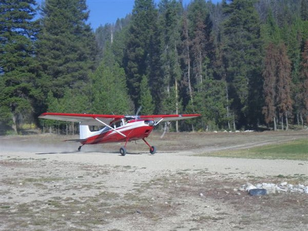 A Cessna 180 Skywagon on a dirt runway at Sulphur Creek
